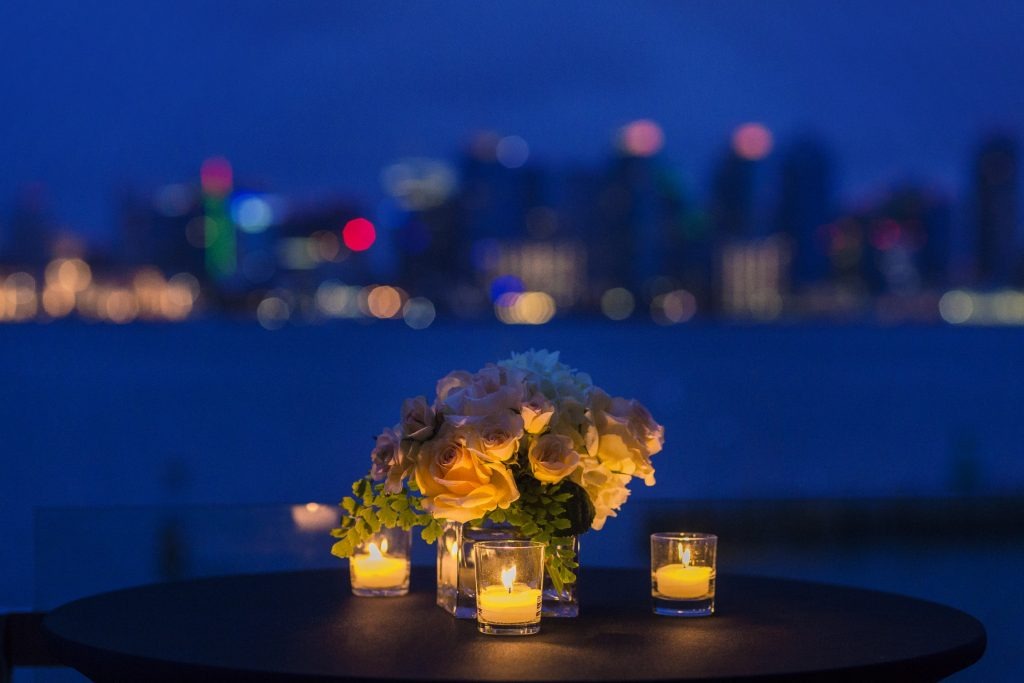 Bouquet and candles at night