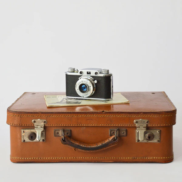 Brown suitcase with camera