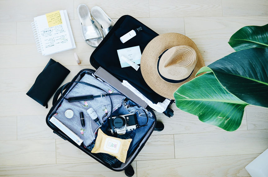 Tropical clothes in a suitcase