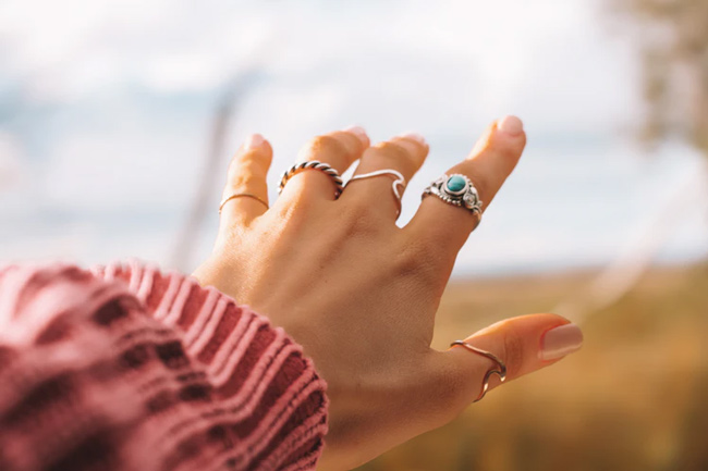 Woman's hand wearing rings