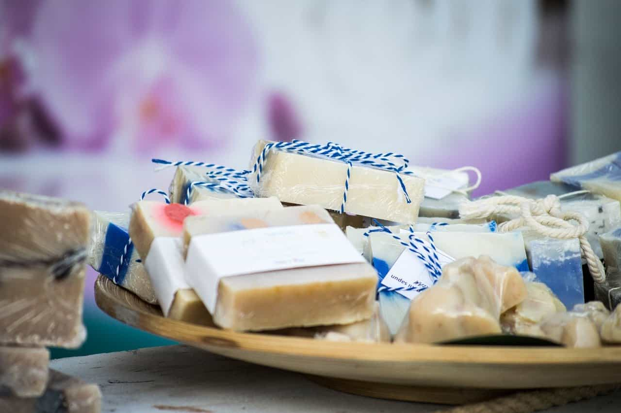 A plate of handmade soap, decorated with paper labels and blue-and-white tie.