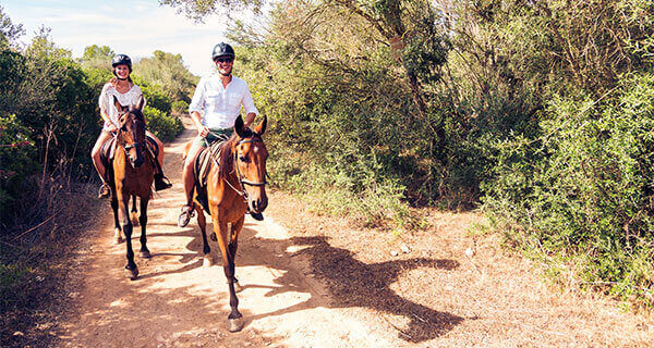 Couple Enjoying horseback riding at casa teresa