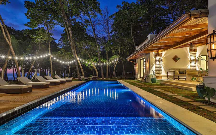 Casa Teresa Luxury Villa pool at night with ocean in the background