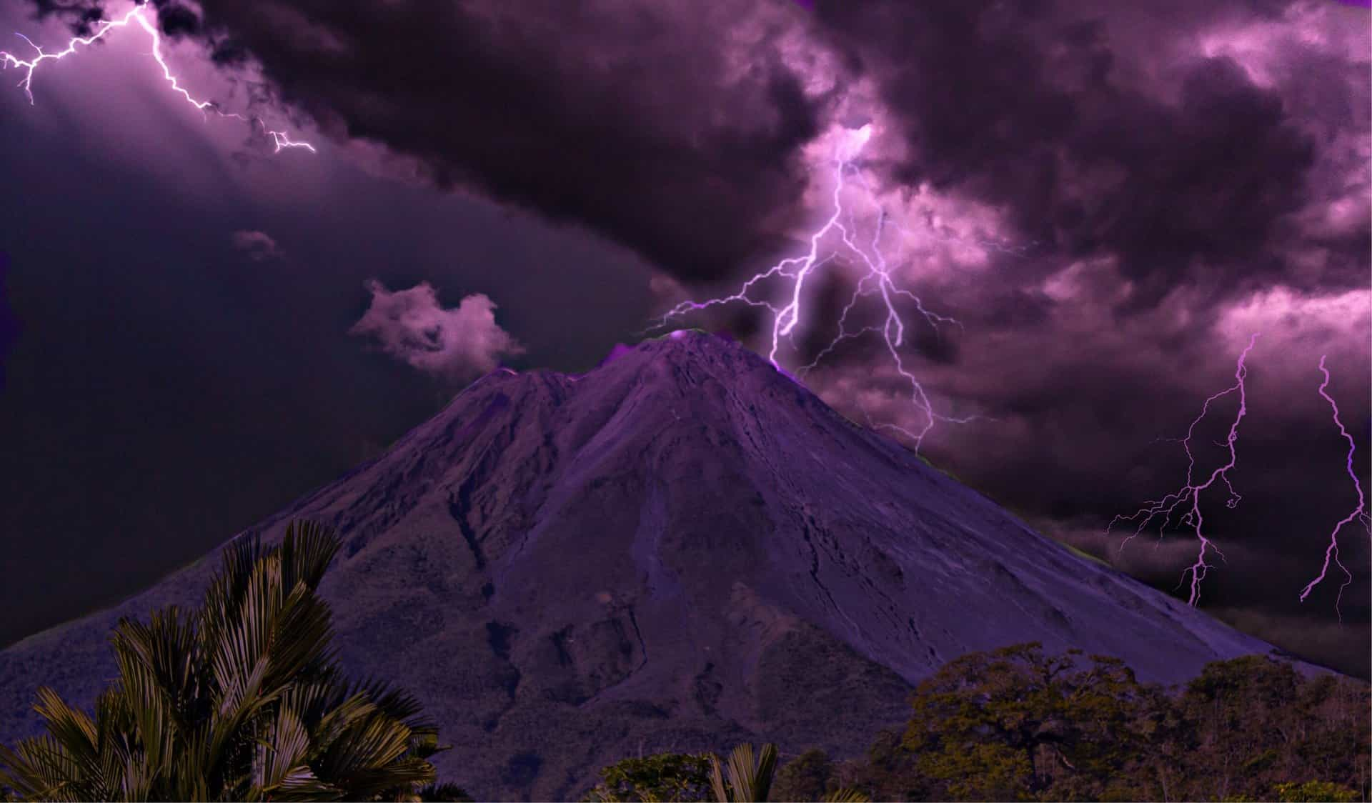 purple stormclouds and lightning over arenal volcano costa rica