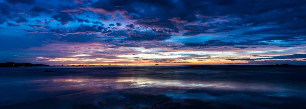 blue and orange sunset over tamarindo beach costa rica