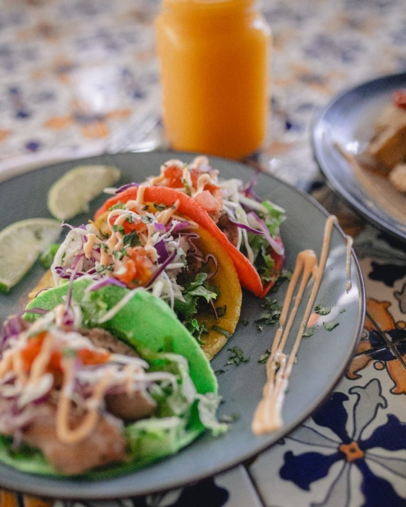Rainbow tacos, a Costa Rican food, on a plate.