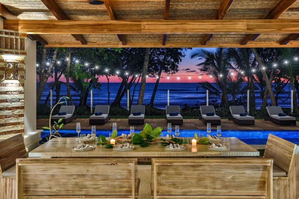 The poolside view from Casa Teresa luxury villa at night