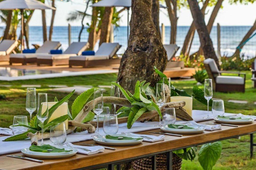 An outdoor setting for beachfront dining at Casa Teresa