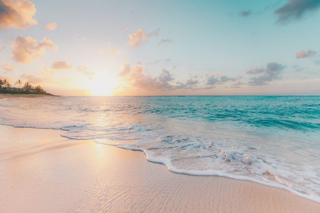 beautiful private beach with a view of the sunset