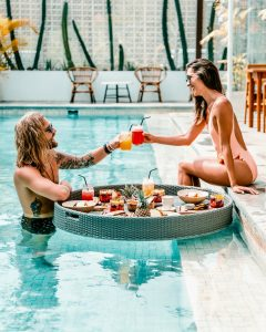 couple enjoying drinks at a pool party